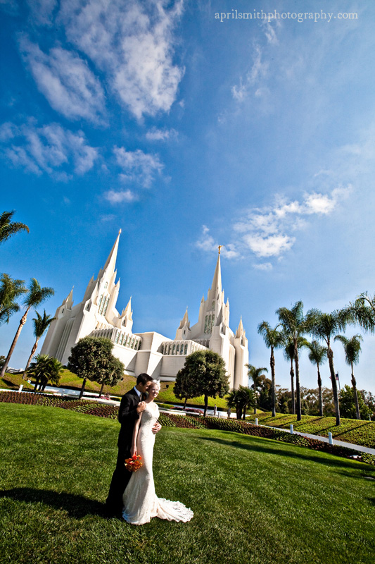 Bride and Groom in foreground of San Diego Temple, April Smith photography
