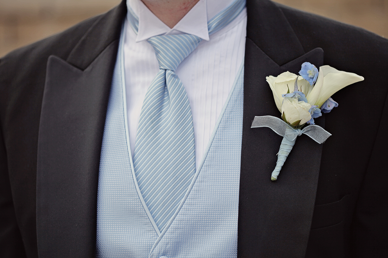 AK, groom, light blue with white vest and boutoner